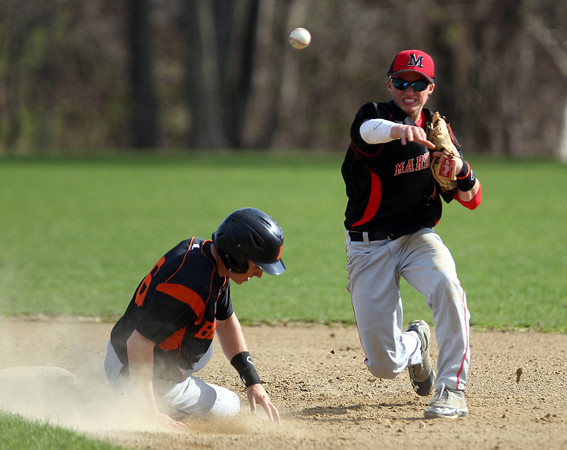 Marblehead sophomore shortstop Tim Kalinowski, right, steps around Beverly's Craig Hall as he slides into second base, and throws onto first to complete a double play on Friday afternoon. DAVID LE/Staff photo. 5/2/14
