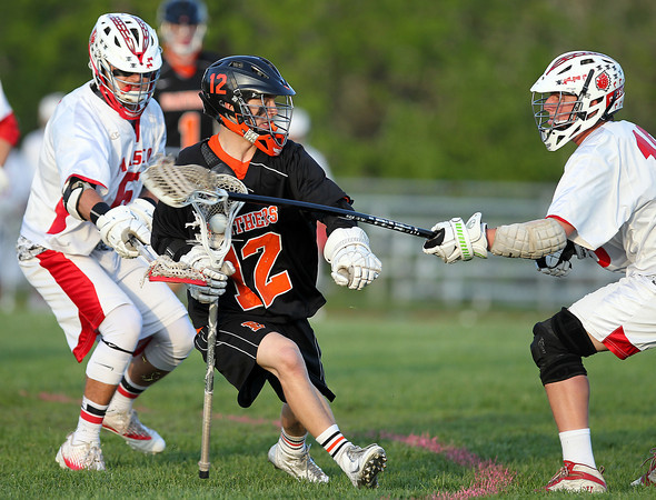 Beverly sophomore attack Hunter Spencer (12) tries to shield the ball from Masco junior defense Corey Tines (6) and senior captain Aidan Sears (18) during the first quarter of play on Wednesday evening. DAVID LE/Staff photo. 5/21/14.