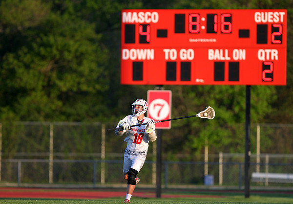 Masco senior captain Aidan Sears (18) carries the ball upfield against Beverly in a 4-2 game in the North Shore Cup on Wednesday evening. DAVID LE/Staff photo. 5/21/14.