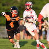 Beverly senior midfielder Jack Atherton (4) tries to defend Masco freshman midfielder Adam Story (29) during the second quarter of play on Wednesday evening. DAVID LE/Staff photo. 5/21/14.