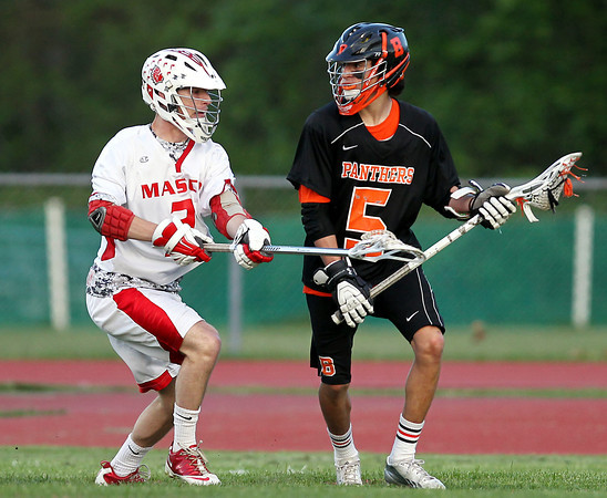 Beverly freshman midfielder Sam Abate (5) looks to make a play while being closely defended by Masco senior defensive midfielder Stephen Pease (2). DAVID LE/Staff photo. 5/21/14.