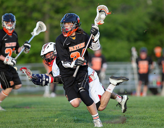 Beverly sophomore Jordan Rawding (34) tries to line up a shot after bowling over Masco senior PJ Criscione (16) during the first quarter of play. DAVID LE/Staff photo. 5/21/14.