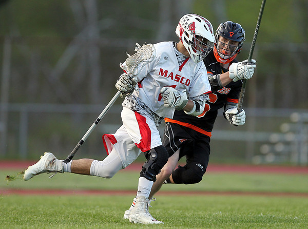 Masco senior attack Ben Hoesly (1) drives towards the net while being defended closely by Beverly sophomore defense Sam Traicoff (6) on Wednesday evening. DAVID LE/Staff photo. 5/21/14.