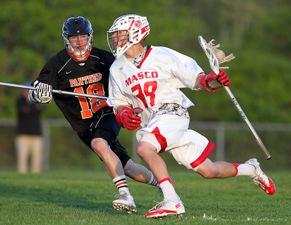 Masco senior captain Harry Cwik (28) drives towards the net as Beverly sophomore defense Harrison Gallagher (18) tries to hold him off. DAVID LE/Staff photo. 5/21/14.
