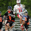 Beverly junior Nick Albano (8) loses his stick after taking a whack at Masco junior midfielder Kevin Gilbert (13) trying to dislodge the ball. DAVID LE/Staff photo. 5/21/14.