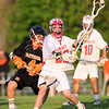 Masco freshman midfielder Adam Story (29) makes a quick pass while being closely defended by Beverly senior midfielder Jack Atherton (4) during the second quarter of play on Wednesday evening. DAVID LE/Staff photo. 5/21/14.