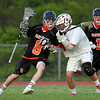 Beverly junior attack Nick Albano (8) collides head on with Masco senior captain Aidan Sears (18) during the second quarter of play as Albano tries to drive to the net. DAVID LE/Staff photo. 5/21/14.
