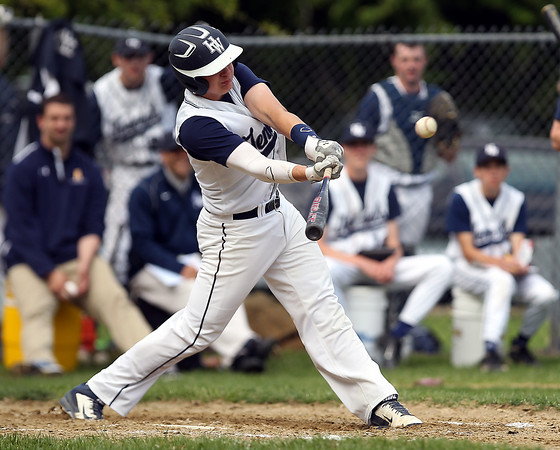 Hamilton-Wenham junior Austen Michel singles to right field off Masco senior starting pitcher Joe Klingensmith. However, Klingensmith pitched a complete game, striking out 12 Generals batters to lead the Chieftans to a 2-1 win on Tuesday afternoon at Patton Park. DAVID LE/Staff photo. 5/20/14