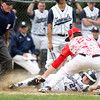 Hamilton-Wenham's Harrison O'Brien (27) slides through the glove of Masco senior pitcher Joe Klingensmith (23) and dislodges the ball to score the Generals first and only run of the game in the bottom of the 7th inning. Klingensmith pitched a complete game, giving up only two hits and striking out 12 Generals batters to lead the Chieftans to a 2-1 win on Tuesday afternoon at Patton Park. DAVID LE/Staff photo. 5/20/14