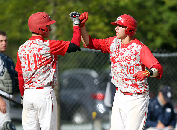 Masco senior catcher Mike Manni (13) gets a fist bump from senior teammate Tom Budrewicz (11) after Manni launched a solo homer off Hamilton-Wenham starter Jack Clay. Behind Manni's home run and a complete game, 12-strikeout performance from senior Joe Klingensmith, the Chieftans defeated the Generals 2-1 on Tuesday afternoon at Patton Park. DAVID LE/Staff photo. 5/20/14