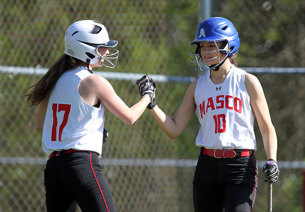 Masco freshman Mackenzie Saitta (17) gets a high five from senior Alexandra Mendelsohn (10) after crossing the plate with the Chieftans second run of the game on an RBI groundout by senior Julianna Kostas. The Chieftans captured the CAL Title with a 7-6 walk off win over the Hornets on Wednesday afternoon. DAVID LE/Staff photo. 5/21/14.