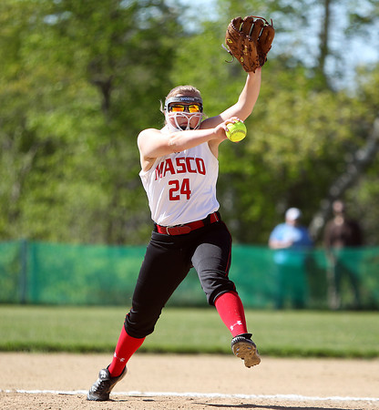 Masco senior pitcher Emily Dow (24) winds up to throw a pitch against North Reading on Wednesday afternoon. DAVID LE/Staff photo. 5/21/14.