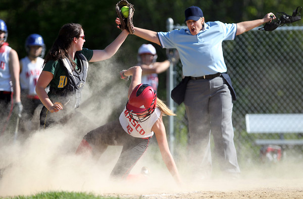 Masco senior Sarah Webster (12) slides safely into home plate amid a cloud of dust as North Reading catcher Sophie Warren (13) holds the ball up for the umpire to see as she gives a safe call. The Chieftans won the CAL title outright with a 7-6 walk off win over the Hornets on Wednesday afternoon. DAVID LE/Staff photo. 5/21/14.