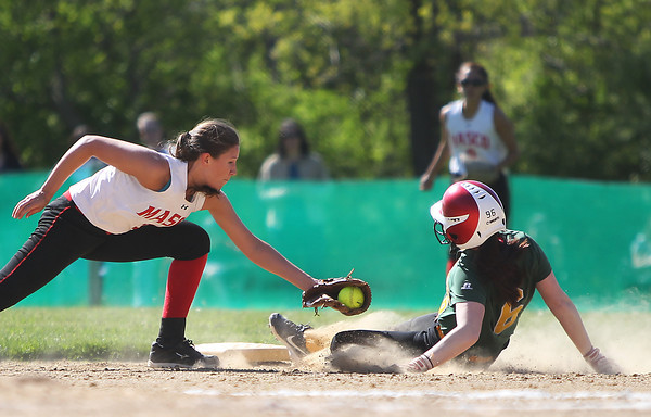 Masco shortstop Casey Maidment (3) stretches out to apply the tag to North Reading's Bryanne Riley (6) as she slides into second base, but  Riley slides in safely for a steal on Wednesday afternoon. DAVID LE/Staff photo. 5/21/14.