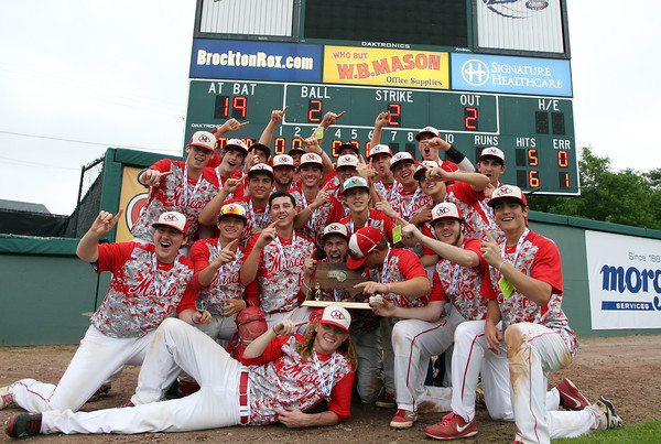 The Masconomet Chieftains pose with the State Championship trophy in front of the score board following  a 10-2 win over Westwood at Campanelli Stadium in Brockton on Thursday afternoon. DAVID LE/Staff photo. 6/12/14