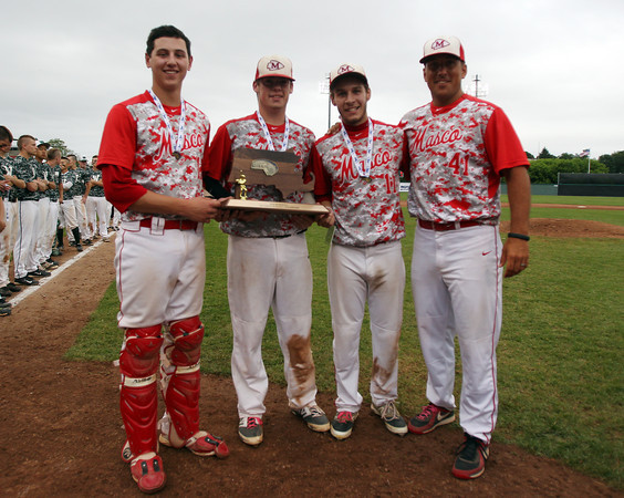 Masconomet senior captains Mike Manni, Joe Klingensmith, and Tom Budrewicz with head coach TJ Baril and the D2 State Championship trophy. The Chieftains captured the D2 State Championship with a 10-2 win over Westwood at Campanelli Stadium in Brockton on Thursday afternoon. DAVID LE/Staff photo. 6/12/14