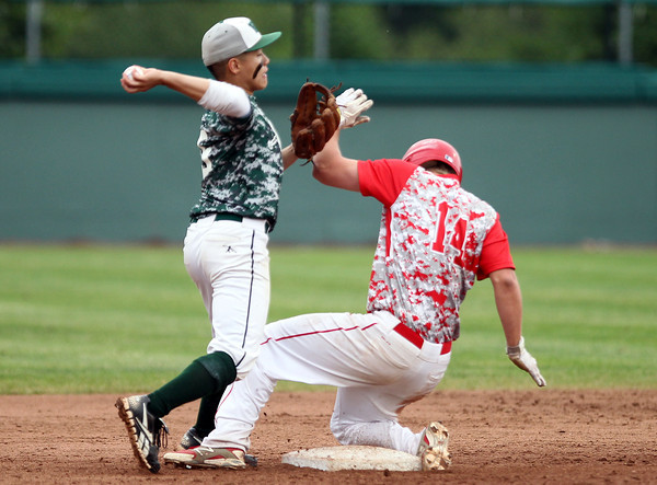 Masco senior Troy Bunker (14) slides hard into second base, breaking up a potential double play by making it a difficult throw for Westwood second baseman Matthew Lo. The Chieftains captured the D2 State Championship with a 10-2 win over Westwood at Campanelli Stadium in Brockton on Thursday afternoon. DAVID LE/Staff photo. 6/12/14