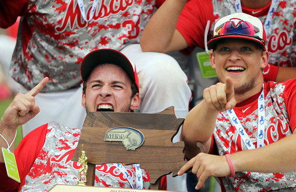 Masco senior captain Tom Budrewicz, left, lets out a whoop of excitement as senior teammate Troy Bunker smiles on after the Chieftains captured the D2 State Championship with a 10-2 win over Westwood at Campanelli Stadium in Brockton on Thursday afternoon. DAVID LE/Staff photo. 6/12/14