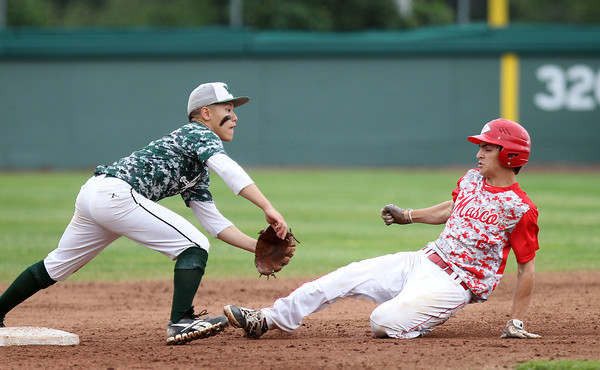 Masco sophomore Elias Varinos slides safely into second base on a steal attempt as Westwood second baseman Matthew Lo waits for the throw. The Chieftains captured the D2 State Championship with a 10-2 win over Westwood at Campanelli Stadium in Brockton on Thursday afternoon. DAVID LE/Staff photo. 6/12/14
