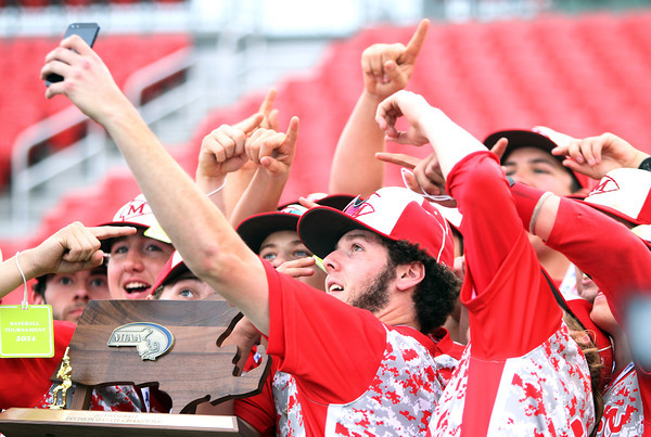 Masco senior Will Twiss, center, takes a team selfie with the D2 State Championship trophy following the Chieftains 10-2 win over Westwood at Campanelli Stadium in Brockton on Thursday afternoon. DAVID LE/Staff photo. 6/12/14