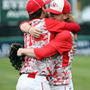 Masco senior captain Tom Budrewicz (11) hugs junior teammate Greg Dougherty after the final out of the Chieftains 10-2 win over Westwood in the D2 State Championship at Campanelli Stadium in Brockton on Thursday afternoon. DAVID LE/Staff photo. 6/12/14