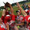 The Masco baseball team begins their celebration after being awarded the D2 State Championship trophy following a 10-2 win over Westwood at Campanelli Stadium in Brockton on Thursday afternoon. DAVID LE/Staff photo. 6/12/14