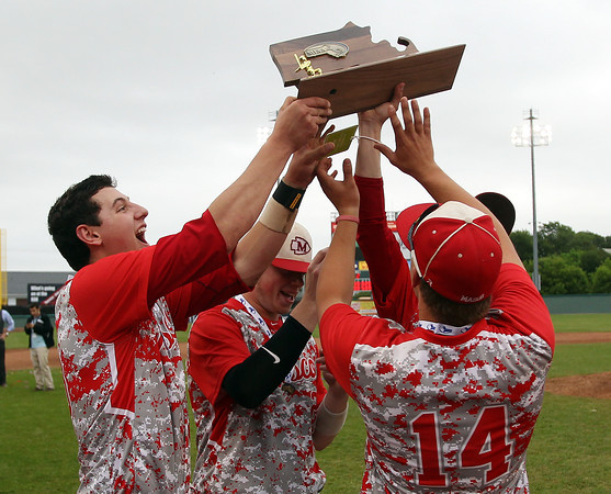 Masco senior captains Mike Manni, Joe Klingensmith, and senior Troy Bunker hoist the D2 State Championship trophy above their heads. The Chieftains captured the D2 State Championship with a 10-2 win over Westwood at Campanelli Stadium in Brockton on Thursday afternoon. DAVID LE/Staff photo. 6/12/14