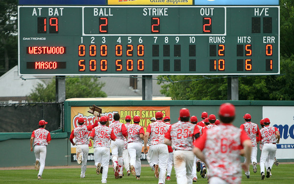 The Masconomet baseball team runs out towards the scoreboard that still flashes the final score of 10-2 as the Chieftains captured the D2 State Championship over Westwood at Campanelli Stadium in Brockton on Thursday afternoon. DAVID LE/Staff photo. 6/12/14
