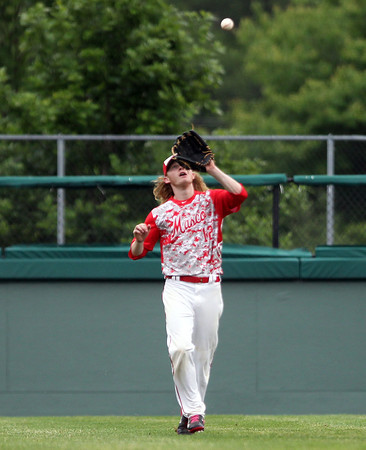 Masco right fielder Greg Dougherty (12) hauls in a fly ball to retire the side against Westwood. The Chieftains captured the D2 State Championship with a 10-2 win over Westwood at Campanelli Stadium in Brockton on Thursday afternoon. DAVID LE/Staff photo. 6/12/14