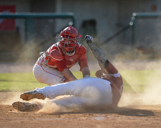 DESI SMITH/Staff photo.    Masco's catcher watches the plate as he puts the tag on Gloucester's Jordan Pallazola for the out during the MIAA North Sectional Championship game held Saturday afternoon at LeLacheur Park in Lowell.    June 7,2014