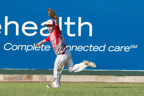 DESI SMITH/Staff photo.    Masco's outfielder Thomas Budrewicz chased down a fly ball deep into right center, stopping Gloucester's come back attempt, during the MIAA North Sectional Championship game held Saturday afternoon at LeLacheur Park in Lowell.    June 7,2014