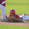 DESI SMITH/Staff photo.    Masco's Elias Varinos just makes it back to first against Gloucester during the MIAA North Sectional Championship game held Saturday afternoon at LeLacheur Park in Lowell.    June 7,2014