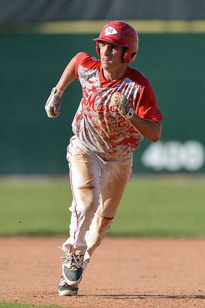 DESI SMITH/Staff photo.    Masco's Elias Varinos takes off to third on a fly ball against Gloucester during the MIAA North Sectional Championship game held Saturday afternoon at LeLacheur Park in Lowell.    June 7,2014