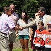 Legendary Boston Bruins defenseman Ray Bourque, right, shakes hands with recently retired Beverly High School coach Bob Gilligan at a groundbreaking ceremony for the new ice hockey rink at Endicott College, which will be named the Raymond J. Bourque Arena and is set to be completed in fall 2015. DAVID LE/Staff photo. 7/29/14.