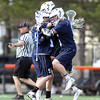 Swampscott's Devin Conroy (5) mobs teammate Andrew Dove (7), after Dove scored the go-ahead goal with under a minute left in the game. The Big Blue won 7-6 to move to 7-0 in the NEC Small Conference. DAVID LE/Staff photo. 5/8/14