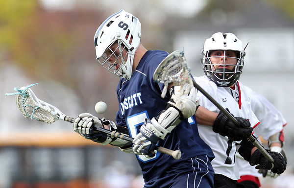 Swampscott face-off man Jason Dignan (25) tries to control a loose ball while being pursued by Salem's JT Kapnis (17) during the second half of play on Thursday afternoon. DAVID LE/Staff photo. 5/8/14