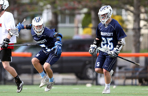 Swampscott freshman Andrew Dove (7) pumps his fist after scoring the go-ahead goal with under a minute to play as Jason Dignan comes over o celebrate. DAVID LE/Staff photo. 5/8/14