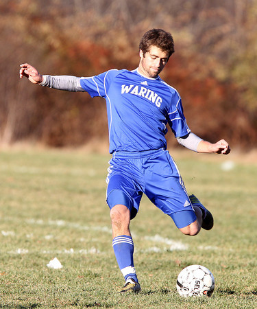Beverly: Waring School's Charlie Mitchell lofts a free kick on goal against St. Andrews on Wednesday afternoon. David Le/Salem News