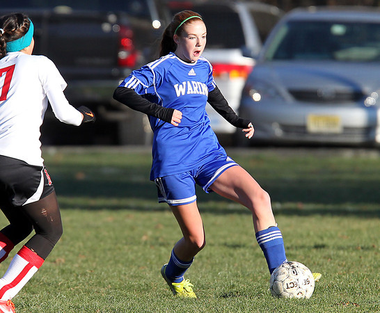 Beverly: Waring School freshman Merilyn Hinrichs carries the ball upfield against Montrose on Wednesday afternoon. David Le/Salem News