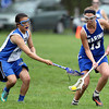 Waring School attack wing Sara Kessler (13) wins a ground ball away from a CHCH player during the second half of play. Waring took down Chapel Hill-Chauncey Hall 20-7 in the Independent Girls Conference (IGC) championship on Friday afternoon at the Waring School in Beverly. DAVID LE/Staff photo. 5/16/14.