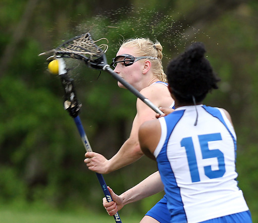 Waring School's Adele MacEwen (2) sprays water in the air as she rips a shot on net against Chapel Hill-Chauncey Hall during the second half of play. Waring took down Chapel Hill-Chauncey Hall 20-7 in the Independent Girls Conference (IGC) championship on Friday afternoon at the Waring School in Beverly. DAVID LE/Staff photo. 5/16/14.