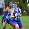 Waring School center Eleanor Lustig (24) looks to turn away from a pressuring defender during the second half of play. Waring took down Chapel Hill-Chauncey Hall 20-7 in the Independent Girls Conference (IGC) championship on Friday afternoon at the Waring School in Beverly. DAVID LE/Staff photo. 5/16/14.