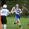 Waring School's Adele MacEwen (2) drives to the net against Chapel Hill-Chauncey Hall during the second half of play. Waring took down Chapel Hill-Chauncey Hall 20-7 in the Independent Girls Conference (IGC) championship on Friday afternoon at the Waring School in Beverly. DAVID LE/Staff photo. 5/16/14.