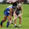 Waring School defense Marguerite Mullen (22), right, battles with a CHCH player for a ground ball on Friday afternoon. Waring took down Chapel Hill-Chauncey Hall 20-7 in the Independent Girls Conference (IGC) championship on Friday afternoon at the Waring School in Beverly. DAVID LE/Staff photo. 5/16/14.