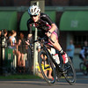Men's Elite rider Austin Vincent speeds through a patch of sunlight during the Witches Cup around Salem Common on Wednesday evening. DAVID LE/Staff photo. 8/6/14.