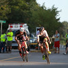 Two riders in the Men's Elite race lead the pack out of the first turn during the Witches Cup around Salem Common on Wednesday evening. DAVID LE/Staff photo. 8/6/14.