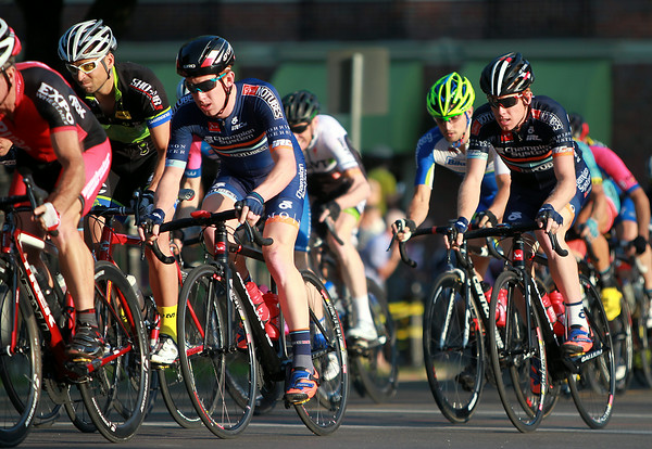 Riders in the Men's Elite race ride through a patch of sunlight in a tight pack during the Witches Cup around Salem Common on Wednesday evening. DAVID LE/Staff photo. 8/6/14.