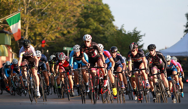 The large field of Men's Elite riders come out of the first turn during the Witches Cup around Salem Common on Wednesday evening. DAVID LE/Staff photo. 8/6/14.
