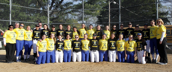 Danvers: The Danvers and Beverly High School softball teams came together for a group photo after their game on Thursday in which both teams sported special jerseys in support of The One Fund. David Le/Salem News