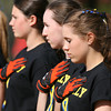 Danvers: Beverly sophomore Hannah Silvestri bows her head and holds her hand over her heart during the singing of the National Anthem on Thursday afternoon. Both the Danvers and Beverly softball teams sported special shirts during their game on Thursday afternoon, supporting The One Fund. David Le/Salem News